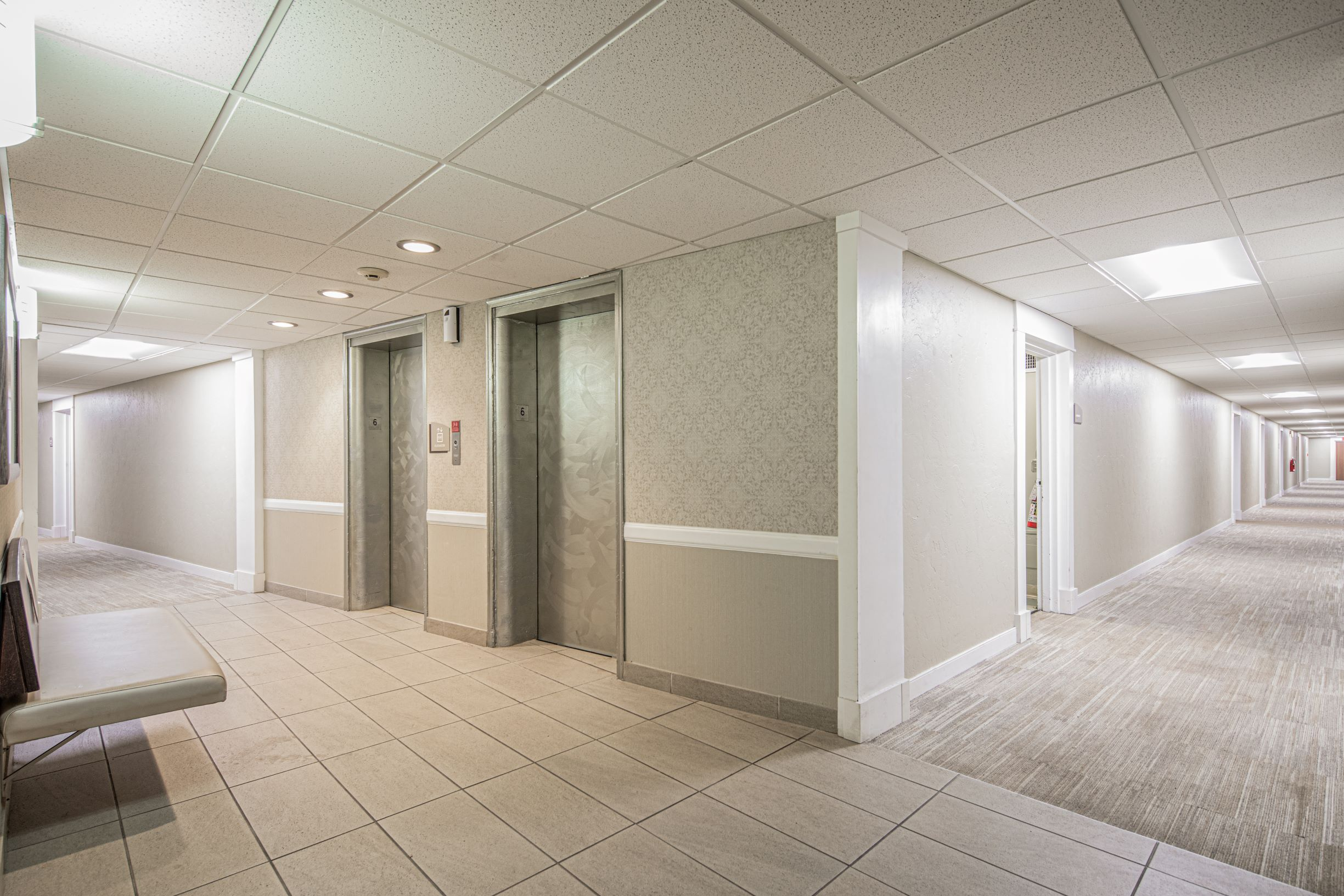 Bright hallways with two elevator banks